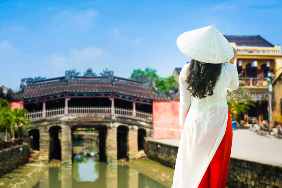 A woman wearing Ao Dai near by Japanese Bridge